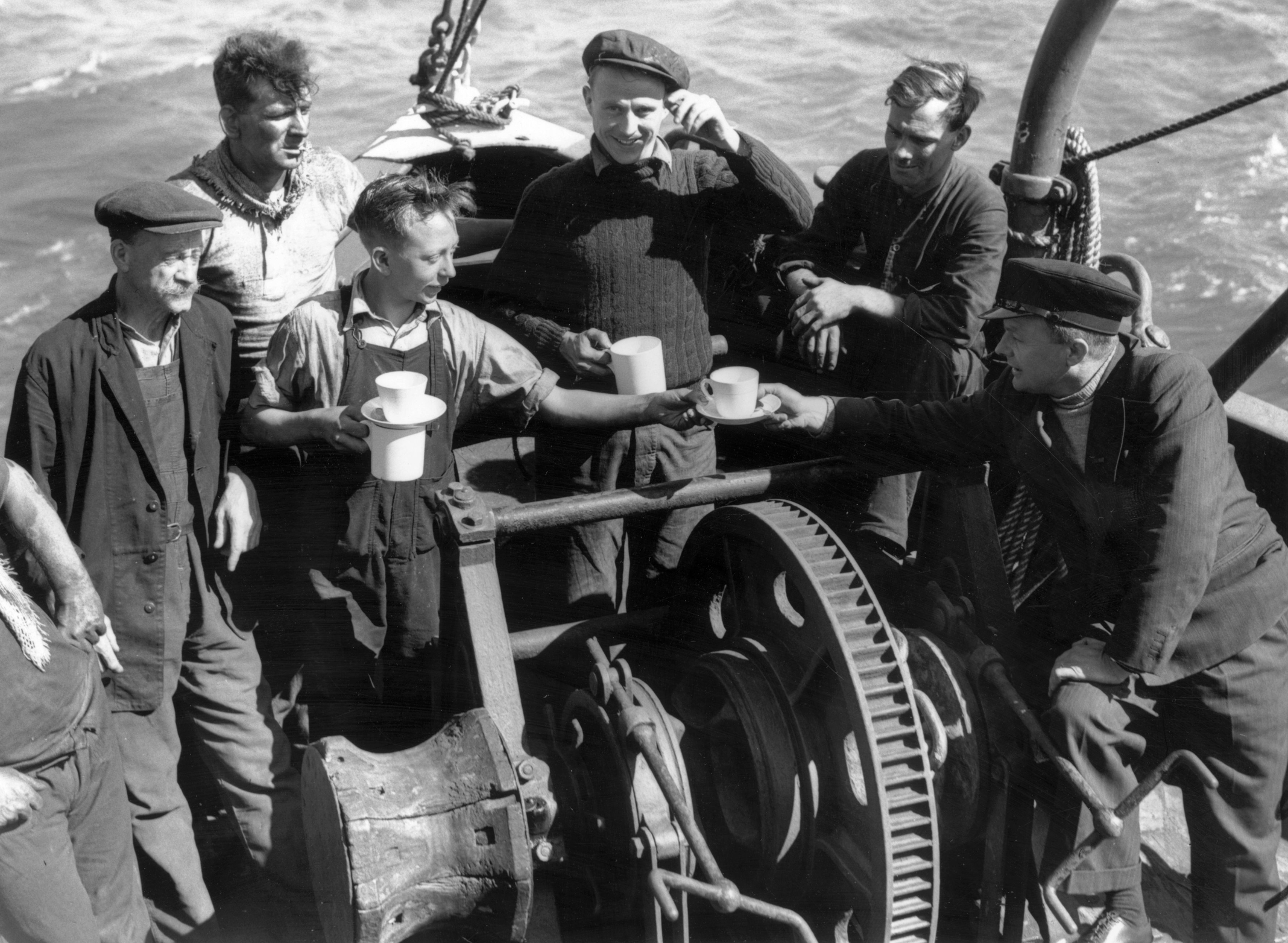 5th June 1940: The crew of the London based tug 'Sunvill' one of the many small craft which took part in the evacuation of British and allied troops from Dunkirk. (Photo by Fox Photos/Getty Images)