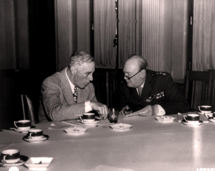 A photograph of President Franklin D. Roosevelt and Prime Minister Winston Churchill discussing Europe's post-war reorganization at Livadia Palace near Yalta, Crimea